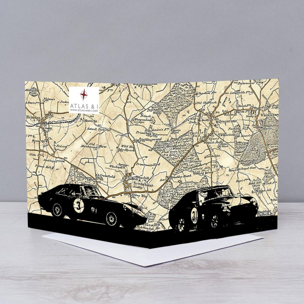 Sports cars over map of Silverstone
